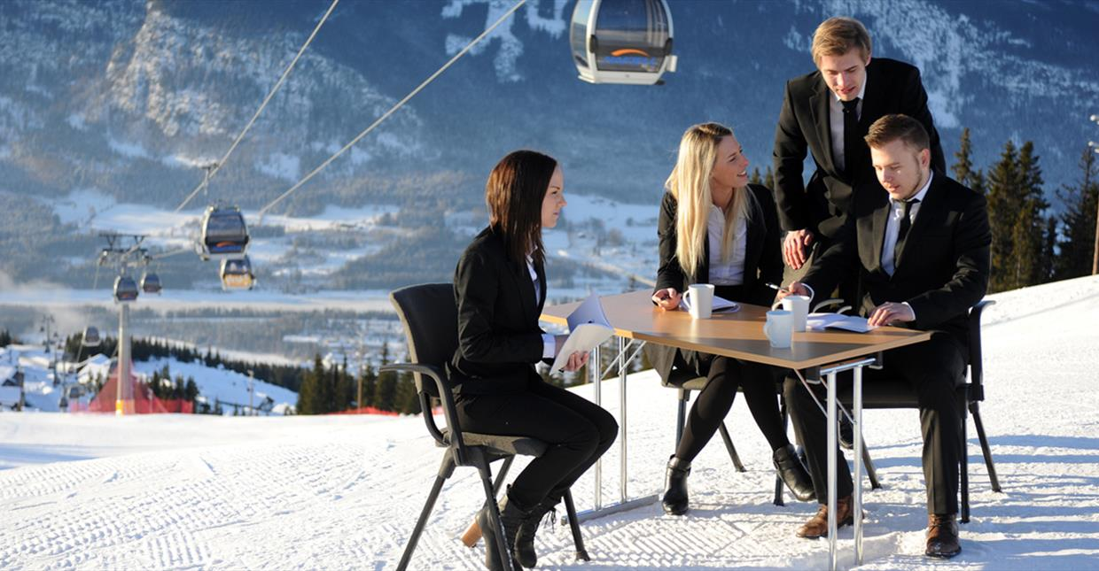 A little conference meeting in the alpine slopes.,
