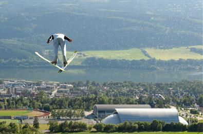 Ski jumper on top of Lillehammer city