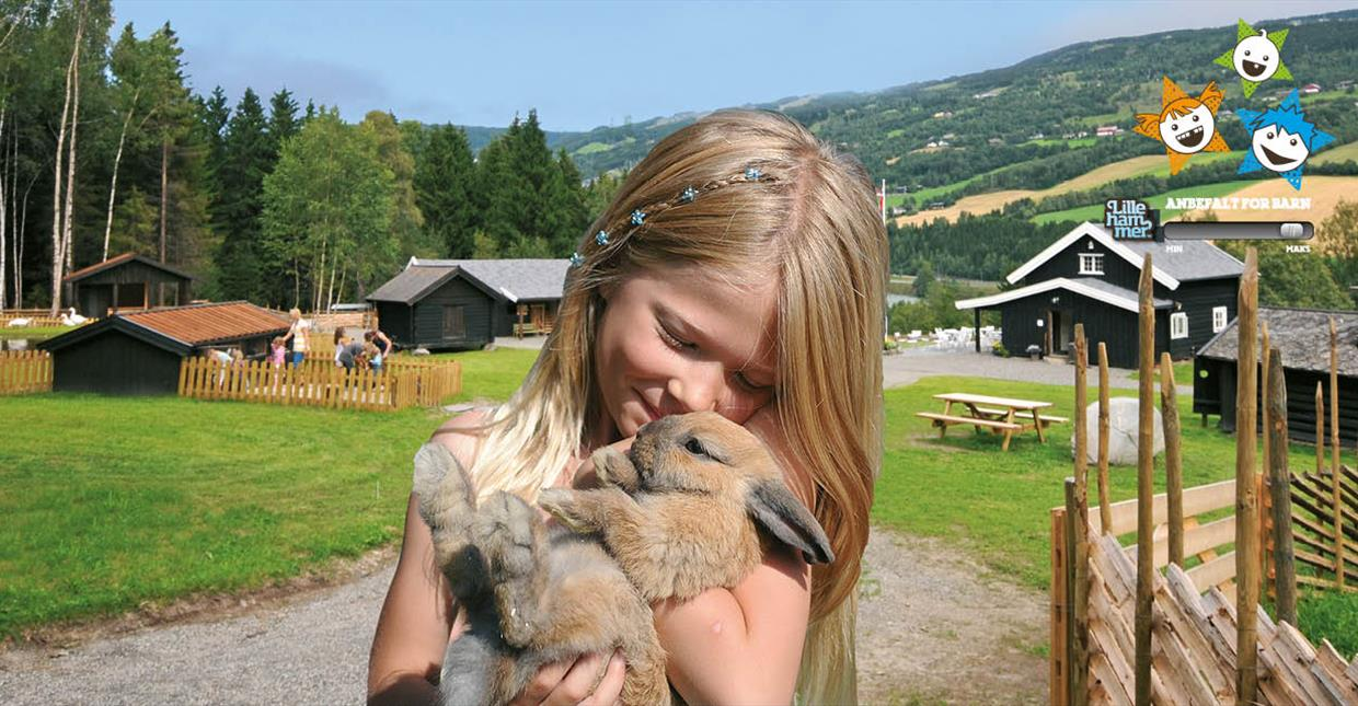 Girl holding rabbit at Children´s Farm Hunderfossen
